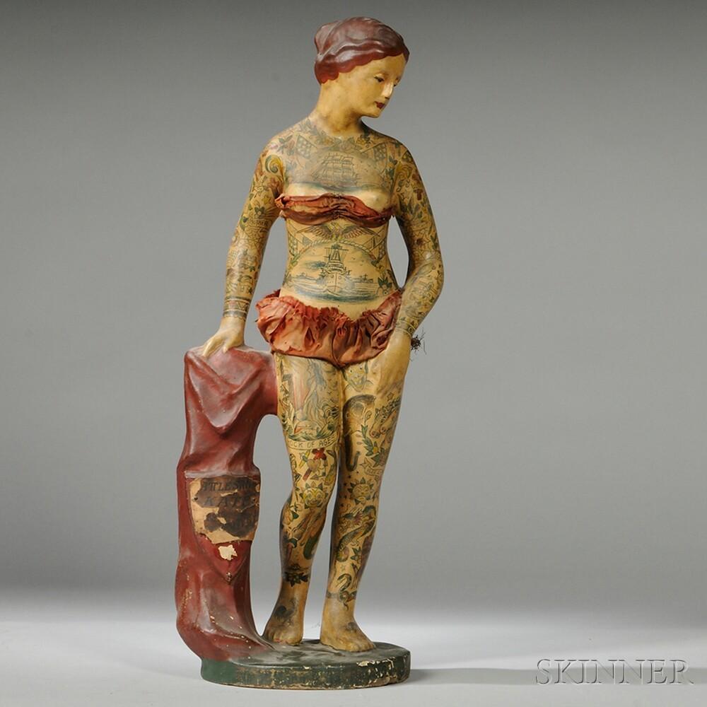 статуэтка татуированной девушки