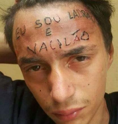 татуировка на лбу: Eu sou ladrao e vacilao - Я вор и неудачник